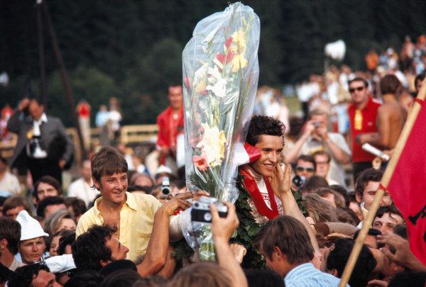 Winner Jacky Ickx celebrates with fans.