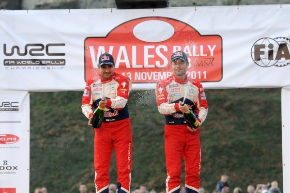 Sebastien Loeb (FRA) and Daniel Elena (MCO) celebrate their 8th World Rally Championship title on the podium in Cardiff Castle.