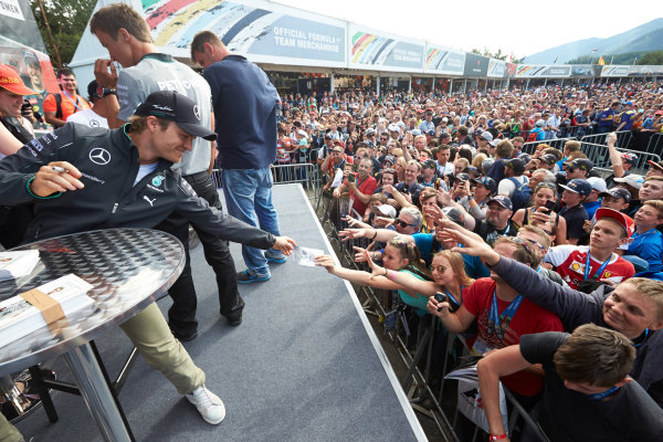 Red Bull Ring, Spielberg, Austria. Saturday 21 June 2014. Nico Rosberg, Mercedes AMG, signs autographs for fans. World Copyright: Steve Etherington/LAT Photographic. ref: Digital Image SNE25339 copy
