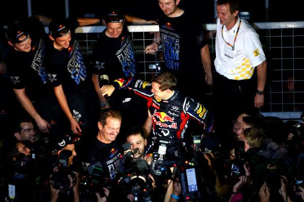 Suzuka Circuit, Suzuka, Japan.9th October 2011.Sebastian Vettel, Red Bull Racing RB7 Renault, 3rd position, celebrates his second world championship with his team. Portrait. Atmosphere. World Copyright: Andy Hone/LAT Photographicref: Digital Image CSP26043