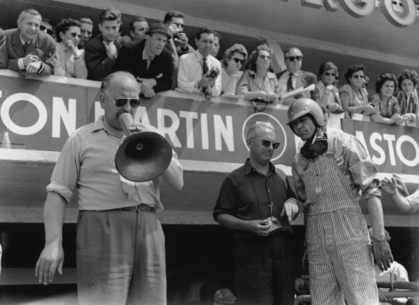 Le Mans, France. 20th - 21st June 1959 Carroll Shelby (Aston Martin DBR1), 1st position,  waits in the pits for the car to come in with Reg Parnell, on megaphone and Team Owner and Chief Designer, David Brown, portrait World Copyright: LAT PhotographicRef: Autocar Glass Plate C55958.