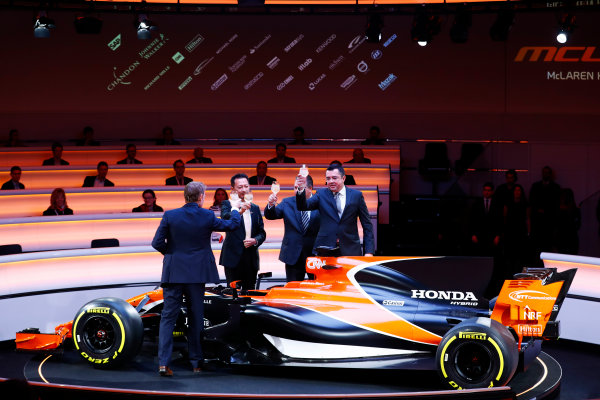McLaren MCL32 Honda Formula 1 Launch. McLaren Technology Centre, Woking, UK. Friday 24 February 2017. L-R: Presenter Simon Lazenby, Yusuke Hasegawa, Senior Managing Officer, Honda, Zak Brown, Executive Director of McLaren Technology Group, and Eric Boullier, Racing Director, McLaren, toast the MCL32. World Copyright: Steven Tee/LAT Images Ref: _O3I5013