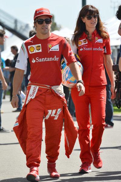Fernando Alonso (ESP) Ferrari and Roberta Vallorosi (ITA) Ferrari Press Officer. Formula One World Championship, Rd1, Australian Grand Prix, Preparations, Albert Park, Melbourne, Australia, Thursday 13 March 2014.