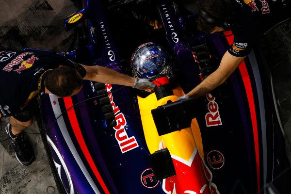 Yas Marina Circuit, Abu Dhabi, United Arab Emirates. Saturday 22 November 2014. Sebastian Vettel, Red Bull Racing RB10 Renault, arrives in Parc Ferme after Qualifying. World Copyright: Charles Coates/LAT Photographic. ref: Digital Image _J5R5108
