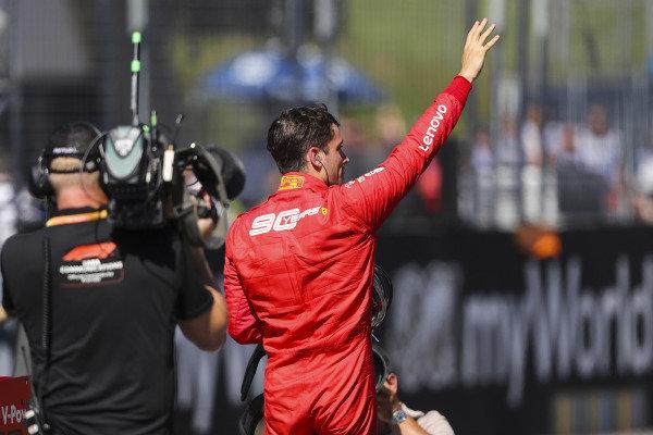 Charles Leclerc, Ferrari, celebrates pole on the grid after Qualifying