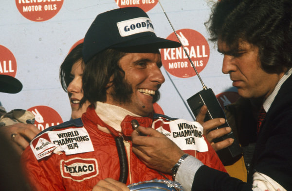 Emerson Fittipaldi gets interviewed on the podium after winning his second world championship.