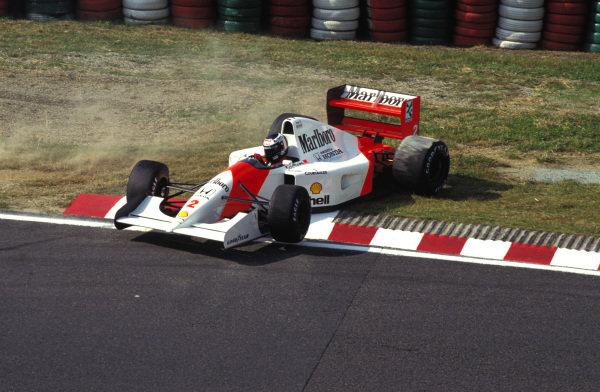 Gerhard Berger, McLaren MP4-7A Honda, spins.