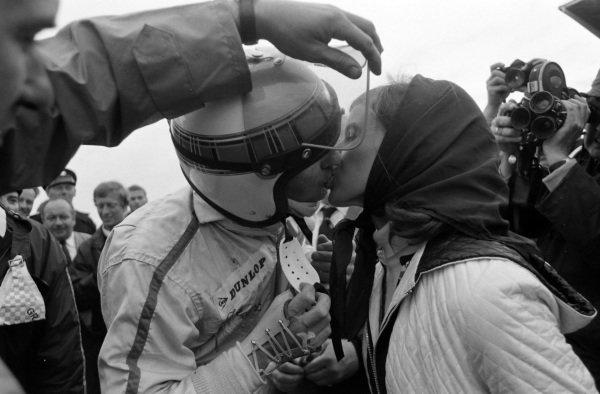 Race winner Jackie Stewart in parc ferme with wife, Helen.