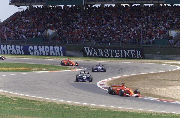 2001 European Grand Prix. RACENurburgring, Germany. 24th June 2001Michael Schumacher, Ferrari F2001, leads the two BMW Williams FW23 of Ralf Schumacher and Juan Pablo Montoya, with team mate Rubens Barrichello, Ferrari F2001, 4th.World Copyright - LAT Photographicref: 8 9 MB Digital File Only