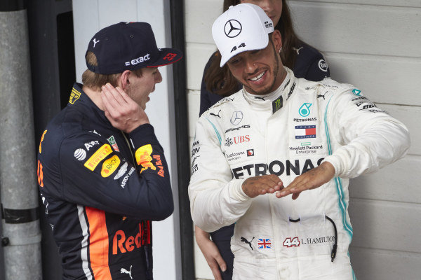 Max Verstappen, Red Bull Racing, 1st position, and Lewis Hamilton, Mercedes AMG F1, talk in Parc Ferme