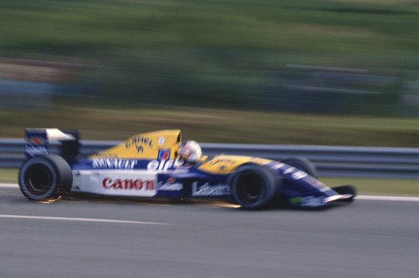 1992 Portuguese Grand Prix.Estoril, Portugal.25-27 September 1992.Nigel Mansell (Williams FW14B Renault).World Copyright - LAT Photographic