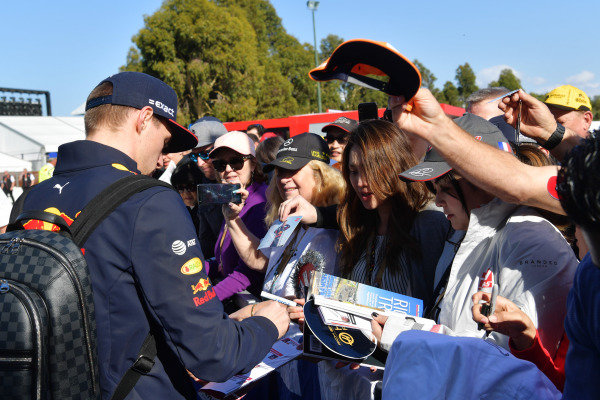 Max Verstappen, Red Bull Racing, signs autographs for fans.