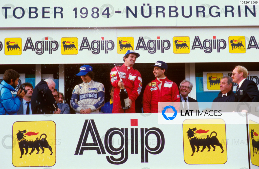 Nurburgring, Germany.5-7 October 1984.Alain Prost (McLaren TAG Porsche) 1st position, Michele Alboreto (Ferrari) 2nd position and Nelson Piquet (Brabham BMW) 3rd position on the podium.Ref-84 EUR 09.World Copyright - LAT Photographic