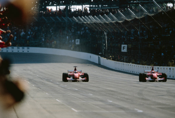 2002 United States Grand PrixIndianapolis, America. 27th - 29th eptember 2002.As Michael Schumacher, Ferrari F2002, slows, team mate Rubens Barrichello, crosses the finish line fractions ahead to take the race win.World Copyright: Charles Coates/LAT Photographicref: 35mm Image 02_USA_27 (60MB Jpeg Image)