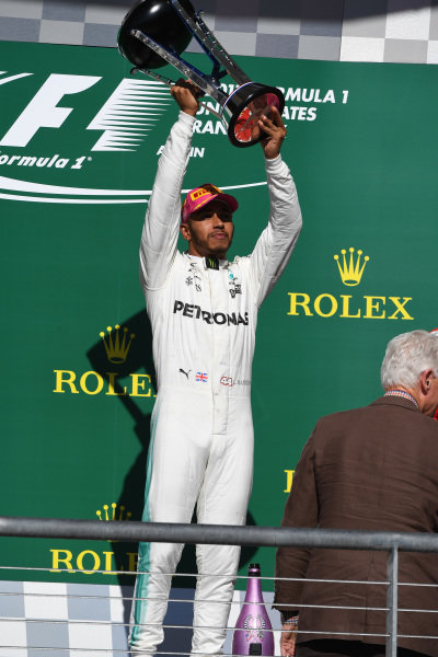 Race winner Lewis Hamilton (GBR) Mercedes AMG F1 celebrates on the podium with the trophy at Formula One World Championship, Rd17, United States Grand Prix, Race, Circuit of the Americas, Austin, Texas, USA, Sunday 22 October 2017.