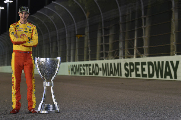 #22: Joey Logano, Team Penske, Ford Fusion Shell Pennzoil with his Championship trophy