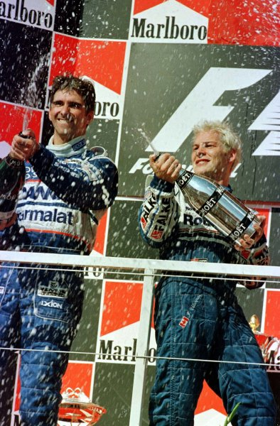 1997 Hungarian Grand Prix.Hungaroring, Budapest, Hungary.8-10 August 1997.Jacques Villeneuve (Williams Renault) and Damon Hill (Arrows Yamaha) celebrate after finishing in 1st and 2nd positions respectively.World Copyright - LAT Photographic