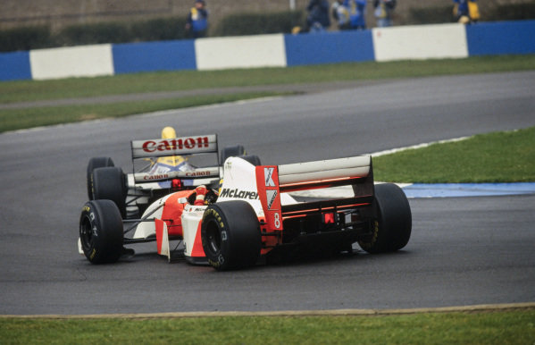 Ayrton Senna, McLaren MP4-8 Ford, follows Alain Prost, Williams FW15C Renault.