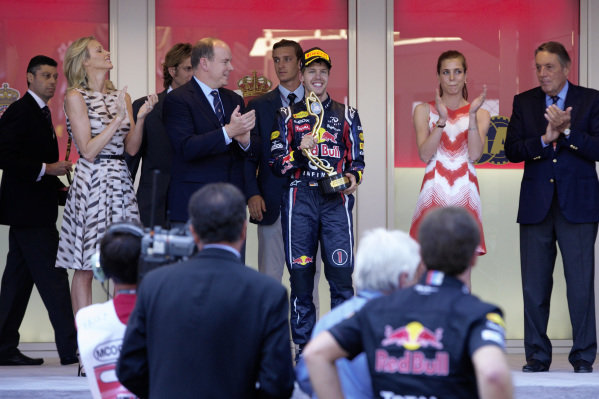 Sebastian Vettel with his trophy on the podium with HSH Prince Albert II and Charlene Wittstock.