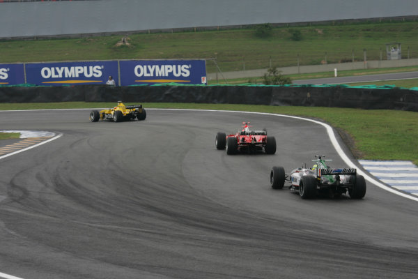 2004 Brazilian Grand Prix-Sunday Race,Sao Paulo, Brazil. 24th October 2004.Christian Klien, Jaguar R5 chases Michael Schumacher, Ferrari F2004 and Timo Glock, Jordan Ford EJ14. Action.World Copyright LAT Photographic/Steven Tee.Digital Image only (a high res version is available on request).