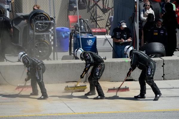 1-3 May, 2015, Monterey, CaliforniaUSA 33, Viper V10, SRT GT3-R, GTD, Ben Keating, Jeroen Bleekemolen crew clean up dirt deposited by car in pit lane. ©2015, Richard Dole LAT Photo USA