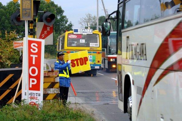 Everybody has to stop before crossing a railway track! 2005 FIA World Rally Championship,  Rally Japan, Leg 2, September 29 - October 2, 2005. Obihiro, Japan. Digital Image