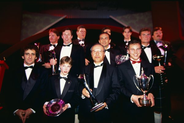 1994 Autosport Awards. Grosvenor House Hotel, Park Lane, London, Great Britain. 4 December 1994. The winners line up at the end of the night, front left-to-right: Alain Prost, Niki Richardson, Riyuchiro Kuze (Subaru) and Jamie Davies. Back l-to-r: Malcolm Wilson, Colin McRae, Ross Brawn (Benetton), Gabriele Tarquini, Damon Hill (hidden), James Matthews, David Coulthard and Norbert Haug (Mercedes-Benz). World Copyright: LAT Photographic Ref: 35mm transparency