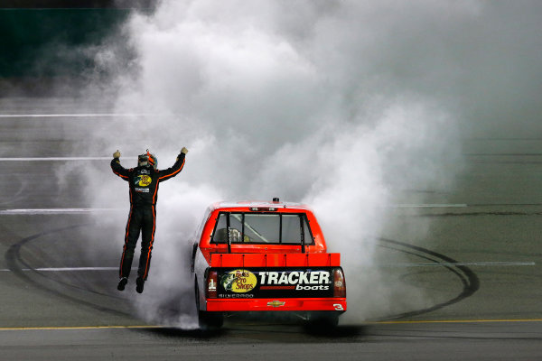 27 June, 2013, Sparta, Kentucky, USA Winner Ty Dillon does a burnout and jumps from the truck © 2013, Michael L. Levitt LAT Photo USA