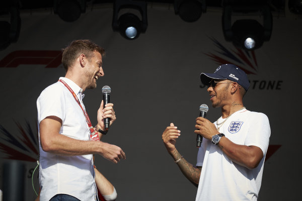 Jenson Button and Lewis Hamilton, Mercedes AMG F1, on stage.