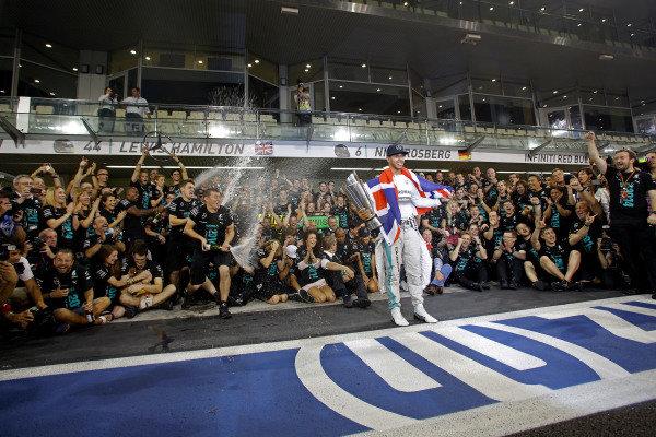 Lewis Hamilton (GBR) Mercedes AMG F1 celebrates with the team. Formula One World Championship, Rd19, Abu Dhabi Grand Prix, Race, Yas Marina Circuit, Abu Dhabi, UAE, Sunday 23 November 2014.  BEST IMAGE