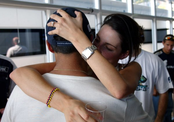Connie Montoya (COL) gives a big kiss to her husband Juan Pablo Montoya (COL) Williams to celebrate his win.Formula One World Championship, Rd12, German Grand Prix, Race Day, Hockenheim, Germany, 3 August 2003.DIGITAL IMAGE