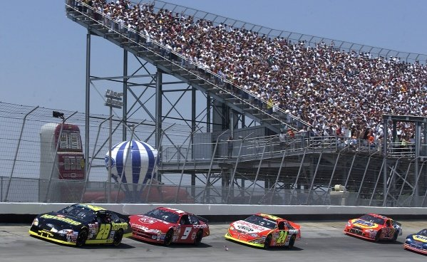 Nineteenth placed Ricky Rudd (USA) Havoline Ford leads the field in front of a packed grandstand.NASCAR Winston Cup Series, MBNA Platinum 400, Dover International Speedway, 2 June 2002. DIGITAL IMAGE