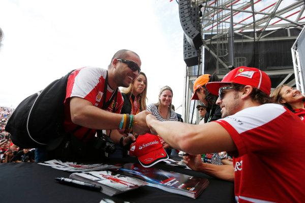 Circuit of the Americas, Austin, Texas, United States of America. Saturday 16th November 2013.  Fernando Alonso, Ferrari, meets a fan. World Copyright: Charles Coates/LAT Photographic. ref: Digital Image _N7T9646