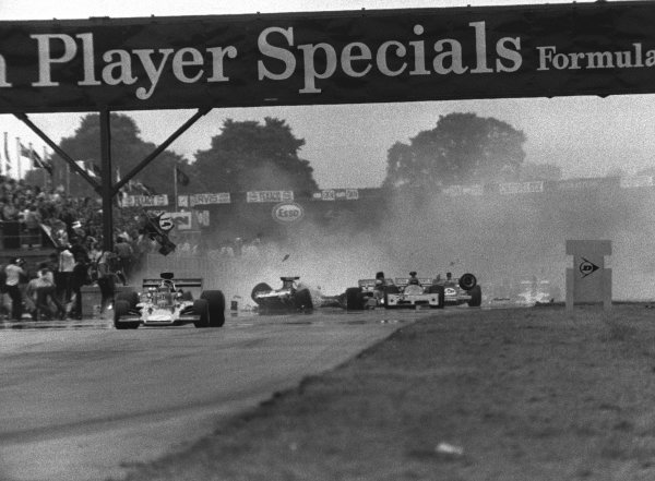 1973 British Grand Prix. Silverstone, England. 12-14 July 1973. Jody Scheckter (McLaren M23 Ford) causes a multiple pile-up at the end of lap 1. Amazingly only Andrea de Adamich was injured. World Copyright - LAT Photographic