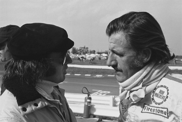 1970 United States Grand Prix. Watkins Glen, New York, USA. 2nd - 4th October 1970. Jackie Stewart (Tyrrell 001-Ford), retired, in conversation with Graham Hill (Lotus 72C-Ford), retired, portrait.  World Copyright: LAT Photographic. Ref:  3348 - 17.