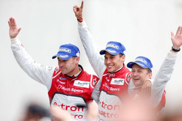 Circuit de La Sarthe, Le Mans, France. 21st-23rd June 2013. Tom Kristensen/Loic Duval/Allan McNish, Audi Sport Team Joest, No 2 Audi R18 e-tron quattro, celebrate win with crowd. World Copyright: Alastair Staley/LAT Photographic ref: Digital Image _R6T7433