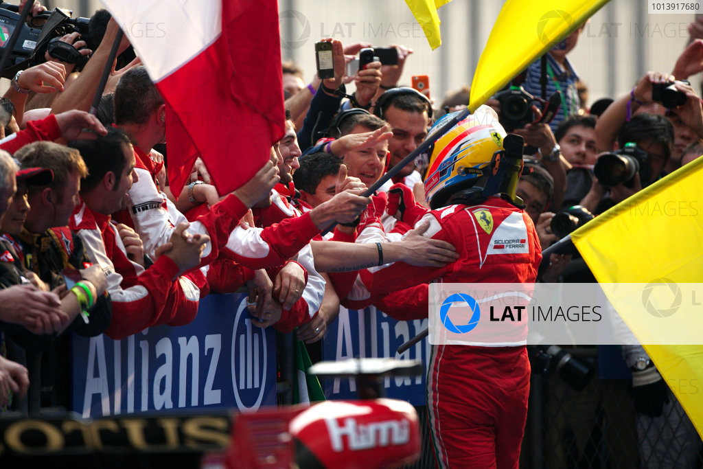 Shanghai International Circuit, Shanghai, China Sunday 14th April 2013 Fernando Alonso, Ferrari, 1st position, celebrates with his team upon arrival in Parc Ferme. World Copyright: Andy Hone/LAT Photographic ref: Digital Image HONZ7753
