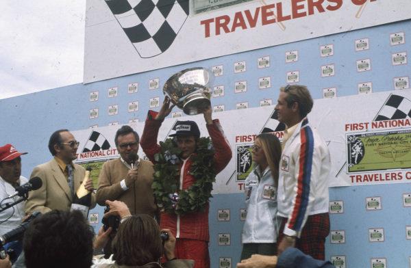Niki Laura celebrates victory on the podium.