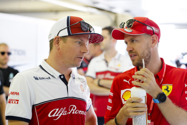 Kimi Raikkonen, Alfa Romeo Racing and Sebastian Vettel, Ferrari before the drivers parade