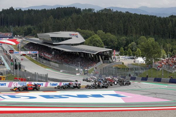 Sergio Perez, Red Bull Racing RB16B, leads Sir Lewis Hamilton, Mercedes W12, Valtteri Bottas, Mercedes W12, Lance Stroll, Aston Martin AMR21, and the remainder of the field at the start