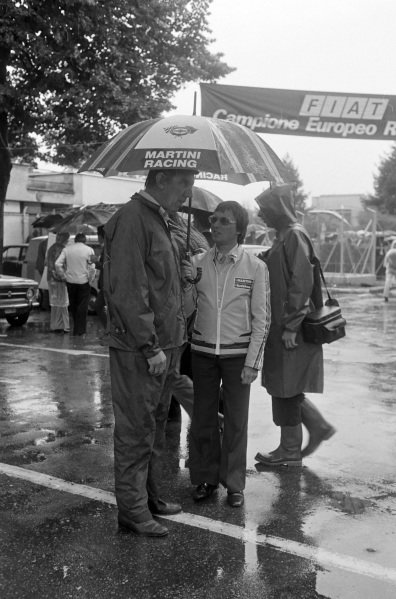 Ken Tyrrell and Bernie Ecclestone chat in the drenched paddock.