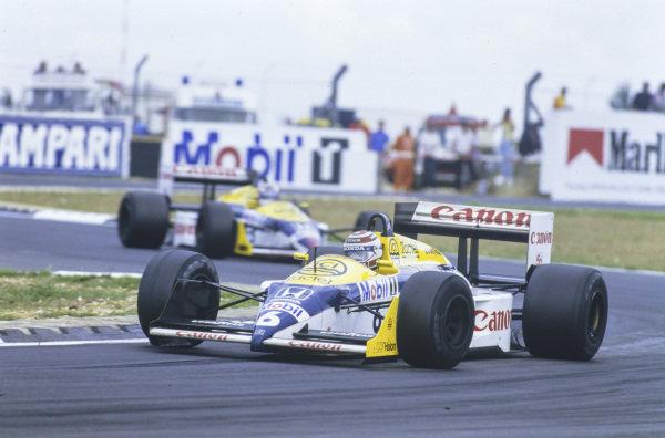 Nelson Piquet, Williams FW11B Honda, leads Nigel Mansell, Williams FW11B Honda.