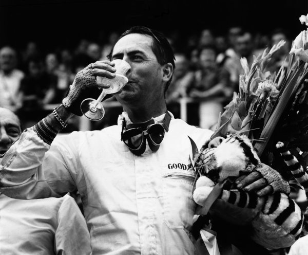 1966 French Grand Prix. Reims, France. 3 July 1966.Jack Brabham, Brabham BT19-Repco, 1st position, celebrates with a glass of Champagne on the podium, portrait. World Copyright - LAT Photographic. Exhibition ref: a062