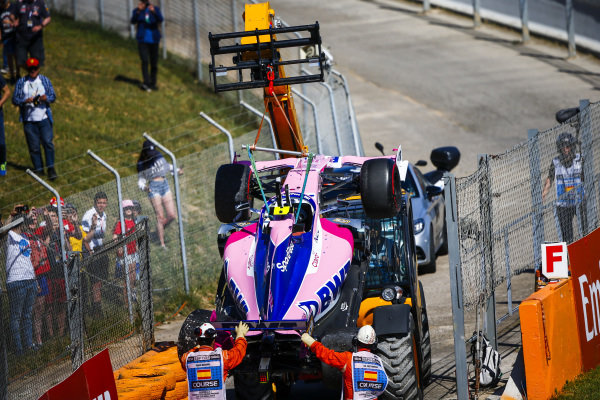 Car of Lance Stroll, Racing Point RP19 being loaded on to the back of a low loader after a crash