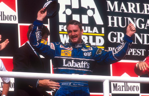 1992 Hungarian Grand Prix.Hungaroring, Budapest, Hungary.14-16 August 1992.Nigel Mansell (Williams Renault) 2nd position, celebrates winning the drivers World Championship on the podium.Ref-92 HUN 09.World Copyright - LAT Photographic