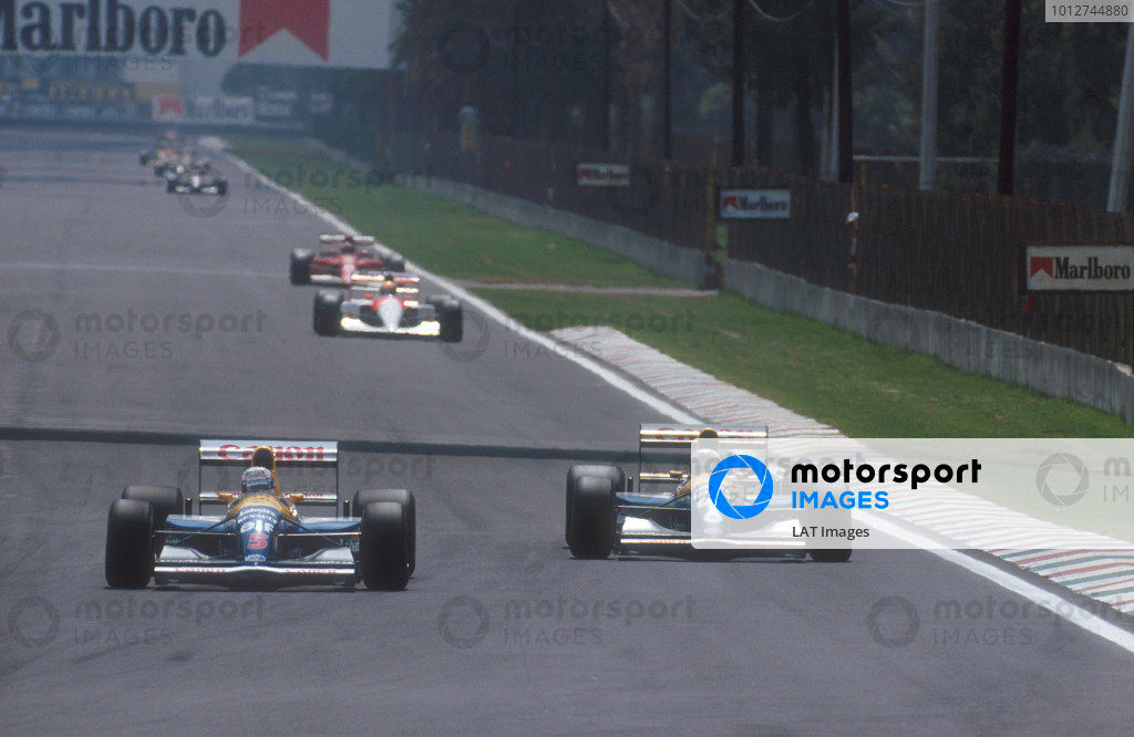 1991 Mexican Grand Prix.Mexico City, Mexico.14-16 June 1991.Nigel Mansell battles with teammate Riccardo Patrese (both Williams FW14 Renault's). They finished in 2nd and 1st positions respectively. Behind Ayrton Senna (McLaren MP4/6 Honda) and Jean Alesi (Ferrari 642) follow.Ref-91 MEX 12.World Copyright - LAT Photographic