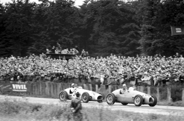 1954 German Grand Prix.Nurburgring, Germany.30/7-1/8 1954.Paul Frere (Gordini 16) leads Robert Manzon (Ecurie Rosier Ferrari 625) who finished in 9th position.World Copyright - LAT Photographic