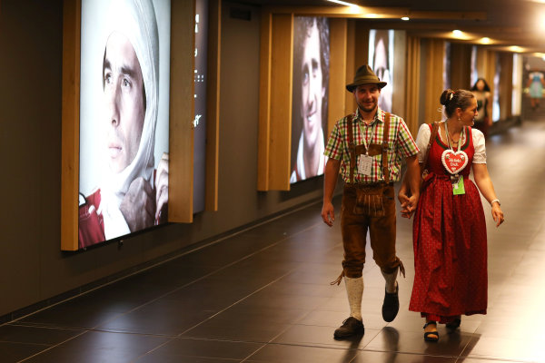 Red Bull Ring, Spielberg, Austria. Sunday 9 July 2017. Traditionally dressed fans walk past a gallery of world champions. World Copyright: Charles Coates/LAT Images ref: Digital Image AN7T3246