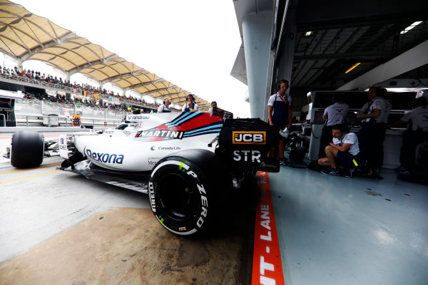 Sepang International Circuit, Sepang, Malaysia. Saturday 30 September 2017. Lance Stroll, Williams FW40 Mercedes, exits his pit garage. World Copyright: Glenn Dunbar/LAT Images  ref: Digital Image _X4I0358