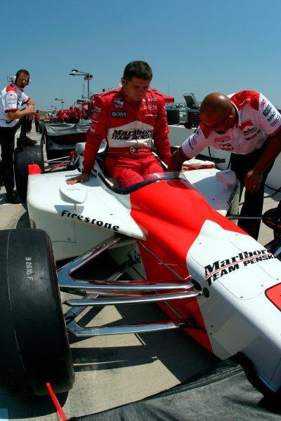 2003 IRL IndyCar Kansas City, 4-6 July 2003Kansas Speedway, Kansas City, KS USAGil de Ferran gently lowers himself into his car-2003 Lesley Ann Miller, USALAT Photographic